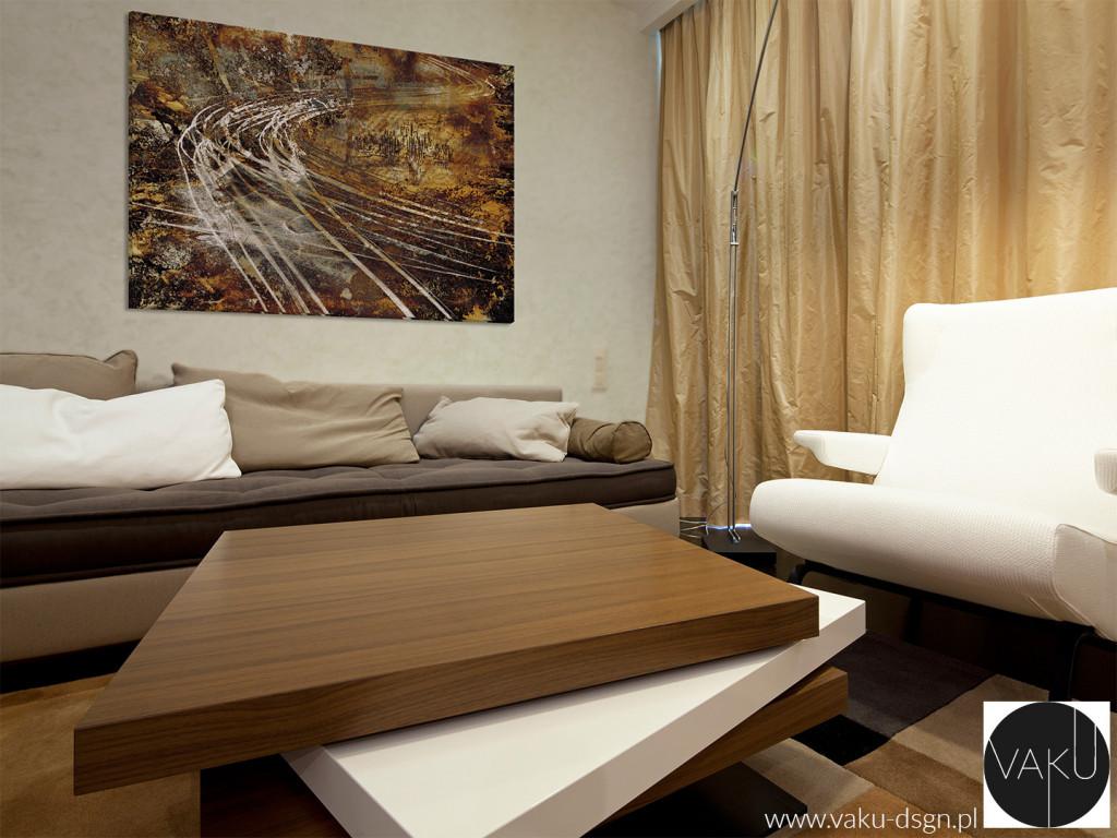 Salon nowoczesnego mieszkania z dominantą w postaci ogromnego obrazu abstrakcyjnego w jednej części.