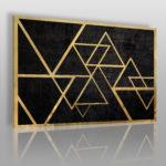 obraz z trójkątami w stylu Bauhaus wykonany w kolorach złotym i czarnym